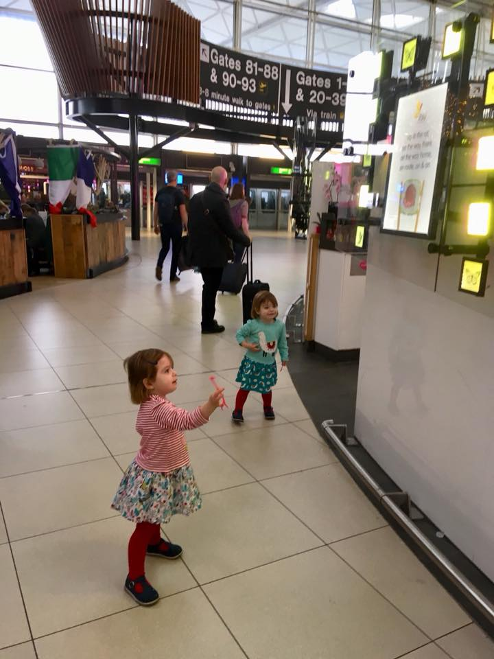 twin toddlers running around the airport