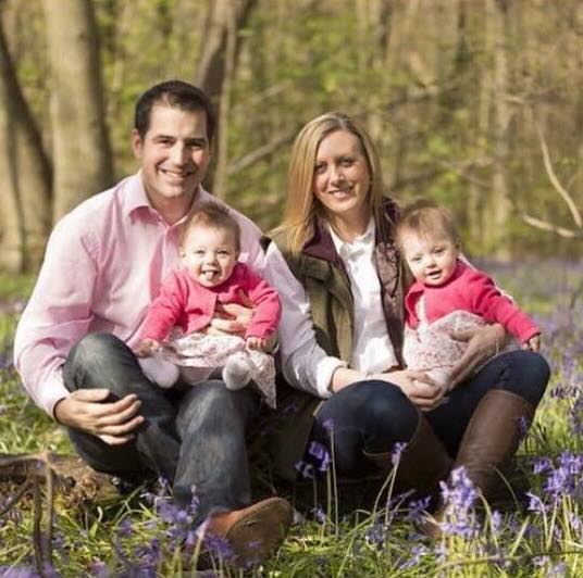 family in the woods with twin babies having a photoshoot