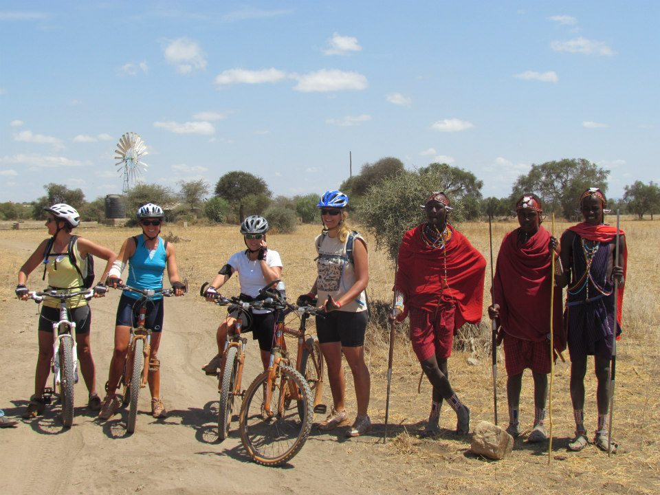 4 ladies cycling through kenya with maasai warriors by their side