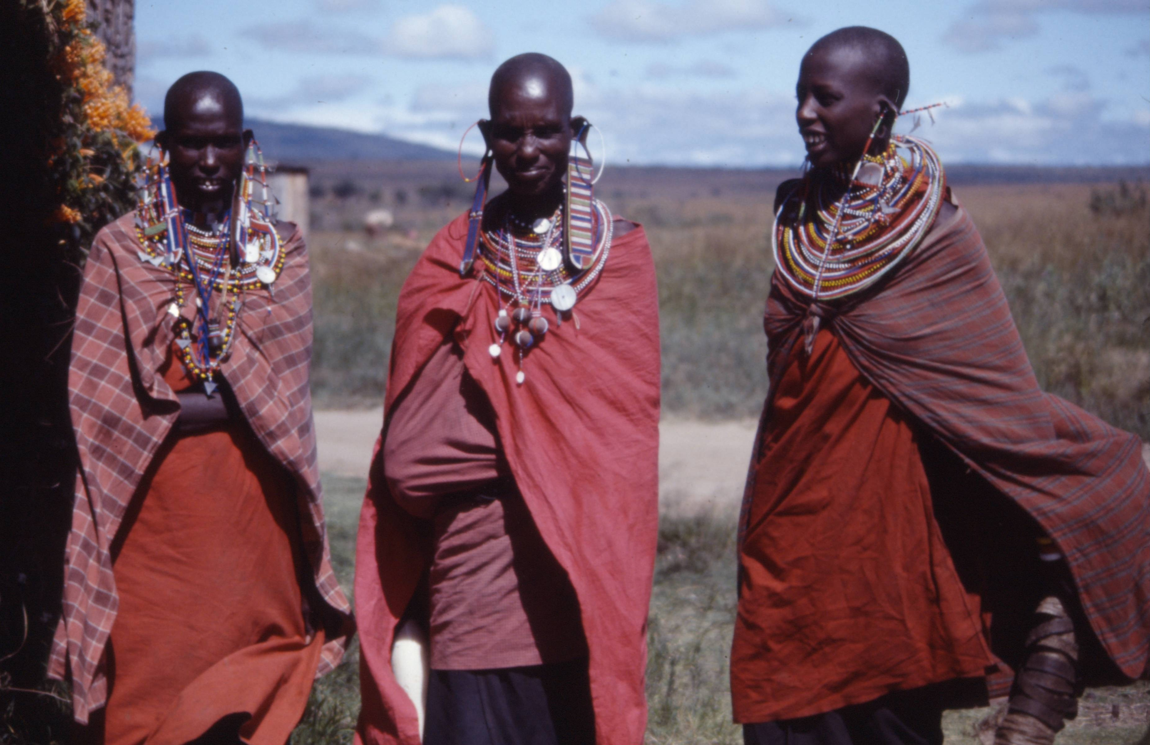 Maasai tribal warriors standing in the Mara