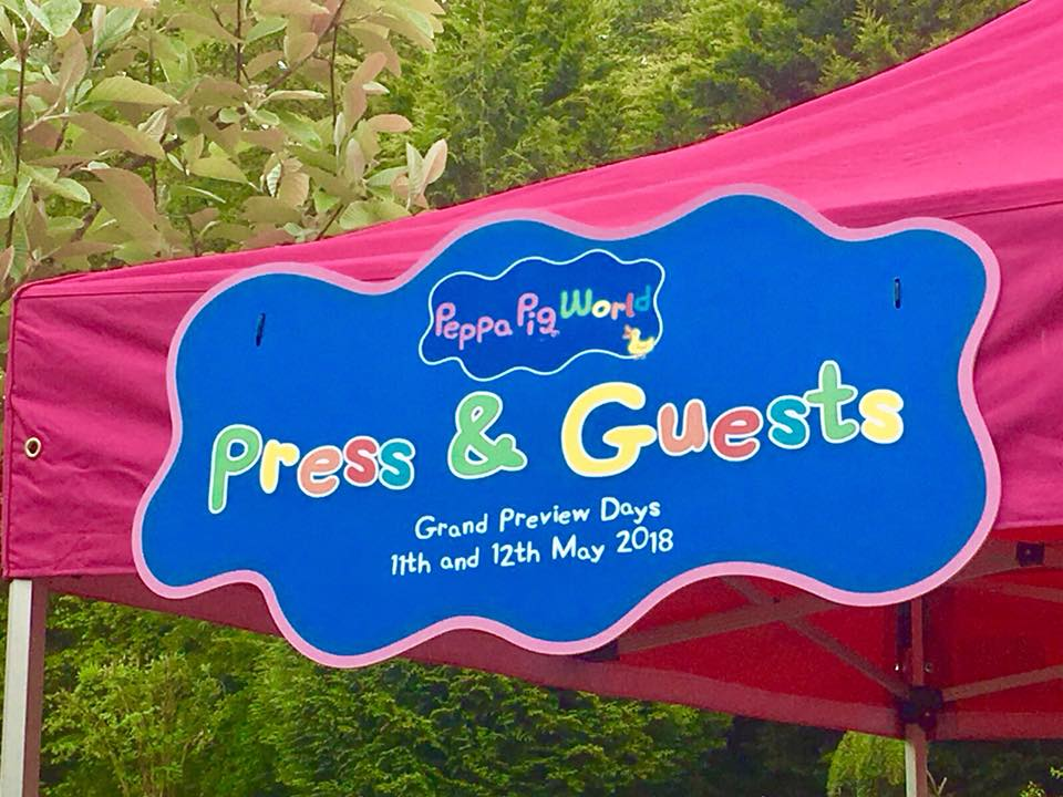 Twins at Peppa Pig World and sign