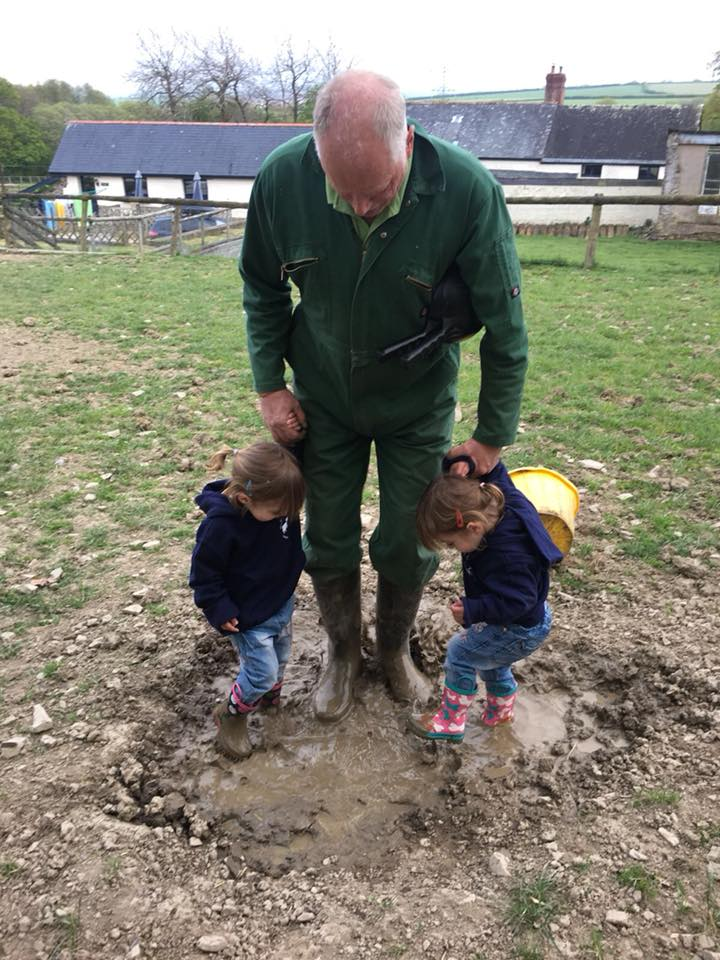 The Popitha Twins are helping Farmer Chris feed the pigs and jumping in the wallow