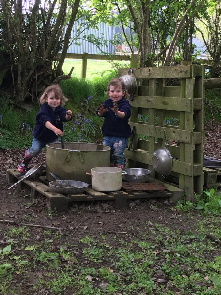 The Popitha Twins playing with mud in the wilderness area North Bradbury Farm