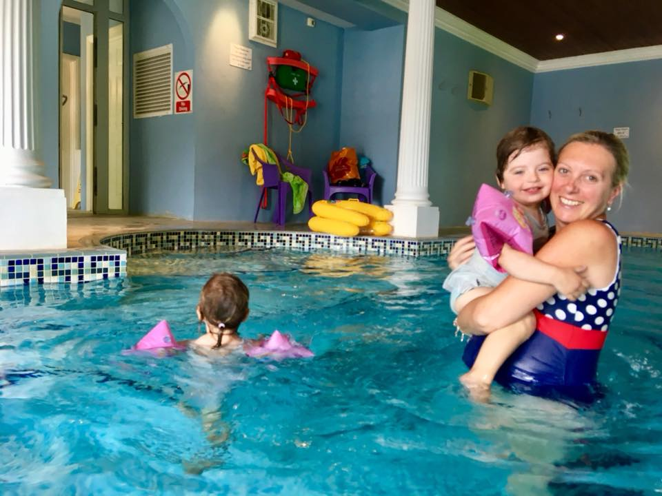 Family travel to Greenwood Grange Dorset. Family with twins in the swimming pool.