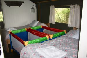 The bedrooms showing cot configurations in one of the safari tents at the Dandelion Hideaway Glamping site