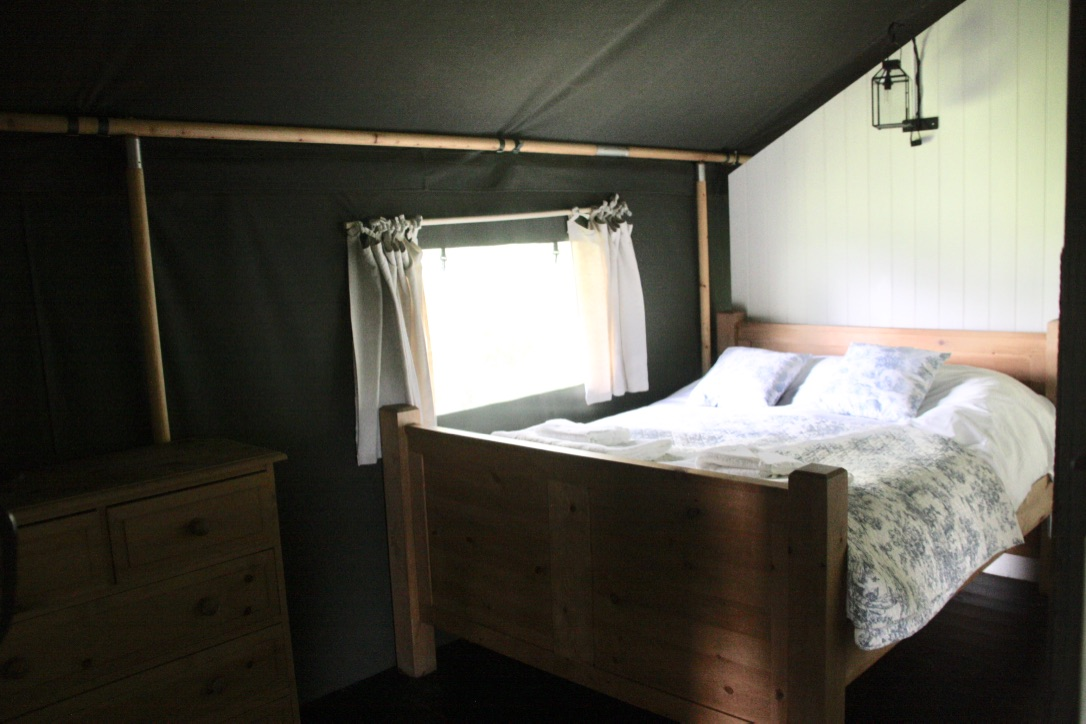 The Double bedroom in one of the safari tents at the Dandelion Hideaway Glamping site
