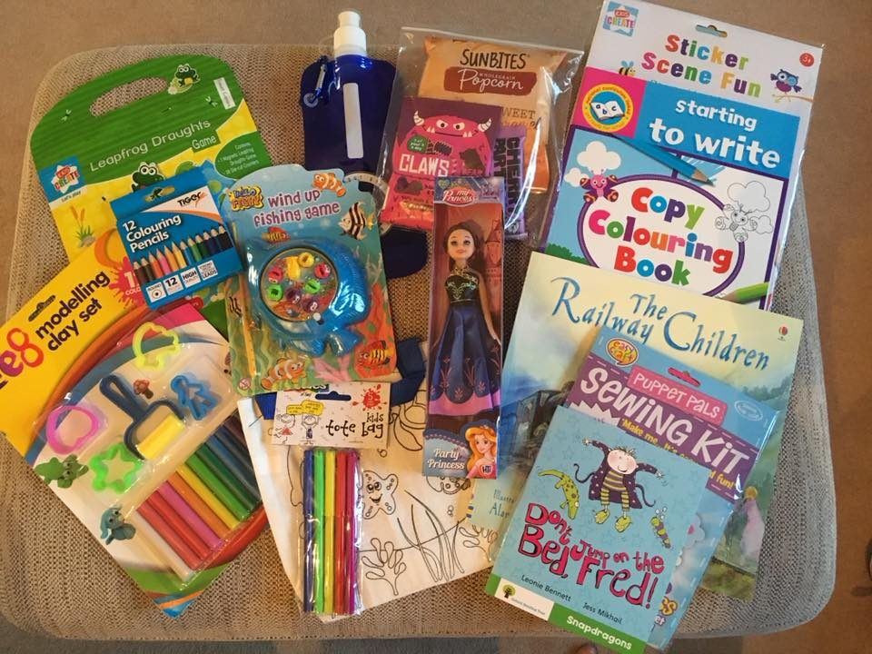 contents of the time out bag including colouring books, toys and stories