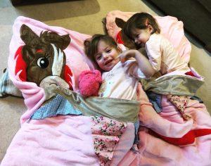 twins in snuggle sacs