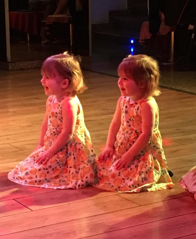 Twins at the disco on holiday