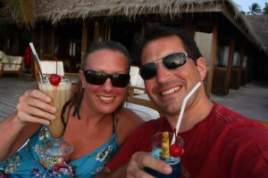 Couple drinking cocktails in the Maldives