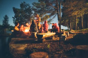 Campfire under the stars with lots of people