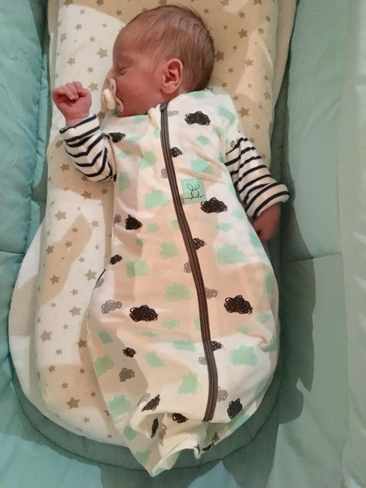 Baby sleeping in a ergo pouch swaddle