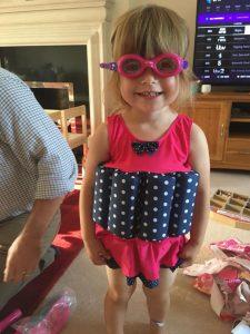 little girl wearing Confidence swim wear