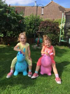 twins on happy hoppers in the garden