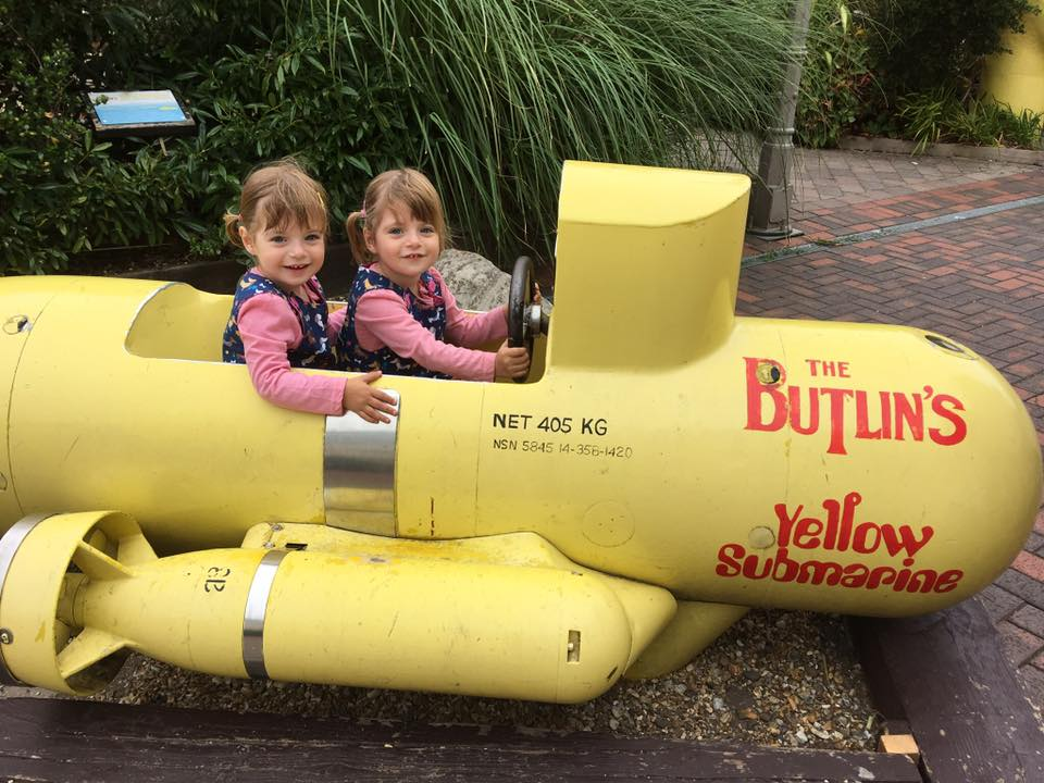 Twins in a mini submarine at Butlins Just for Tots weekend which is one of the best UK Holidays with Toddlers