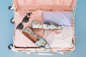 suitcase filled with ladies clothes