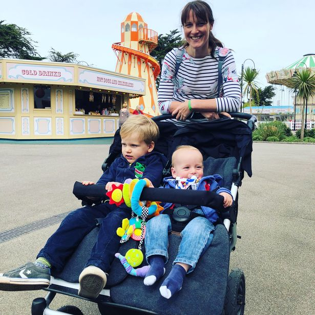 mummy pushing a buggy around Butlins just for tots Minehead