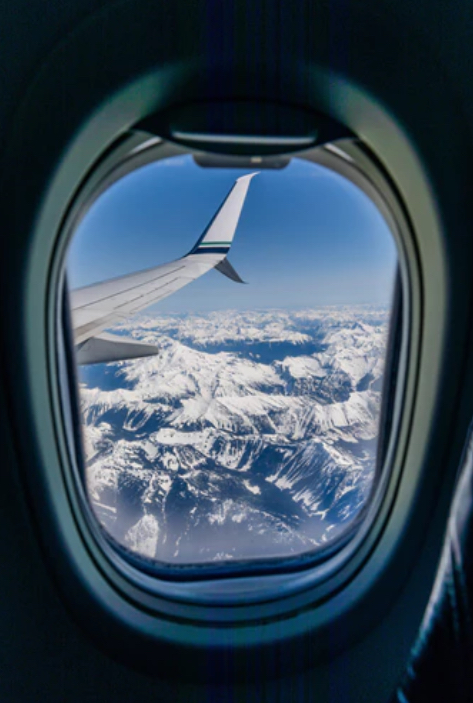 Airplane flying with a view out of the window