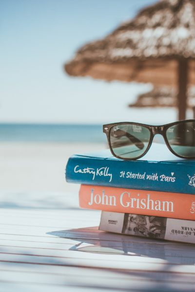 beach holiday with books and sunglasses