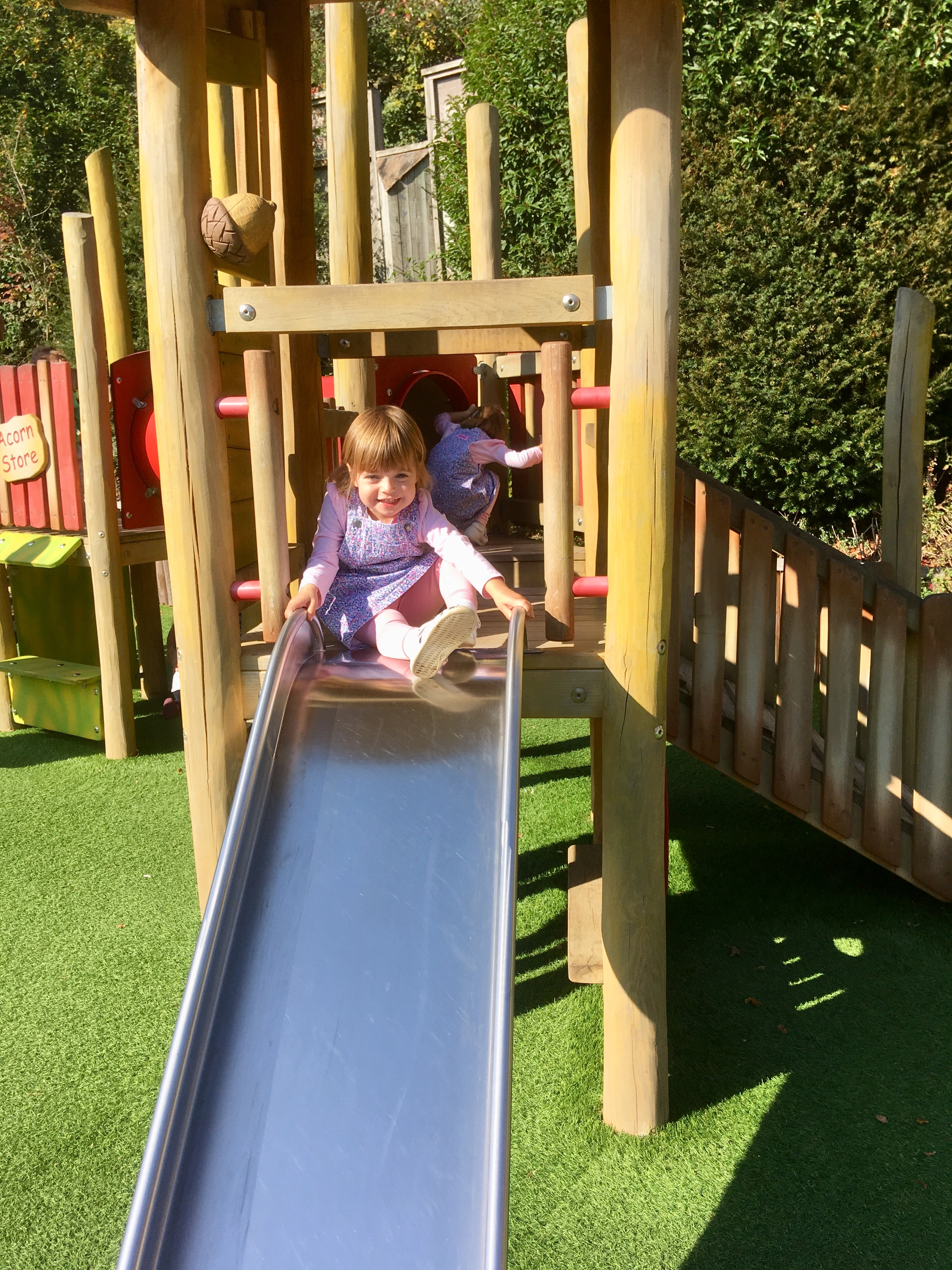 toddler on a slide at longleat