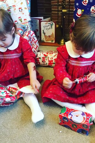 twins opening presents at Christmas