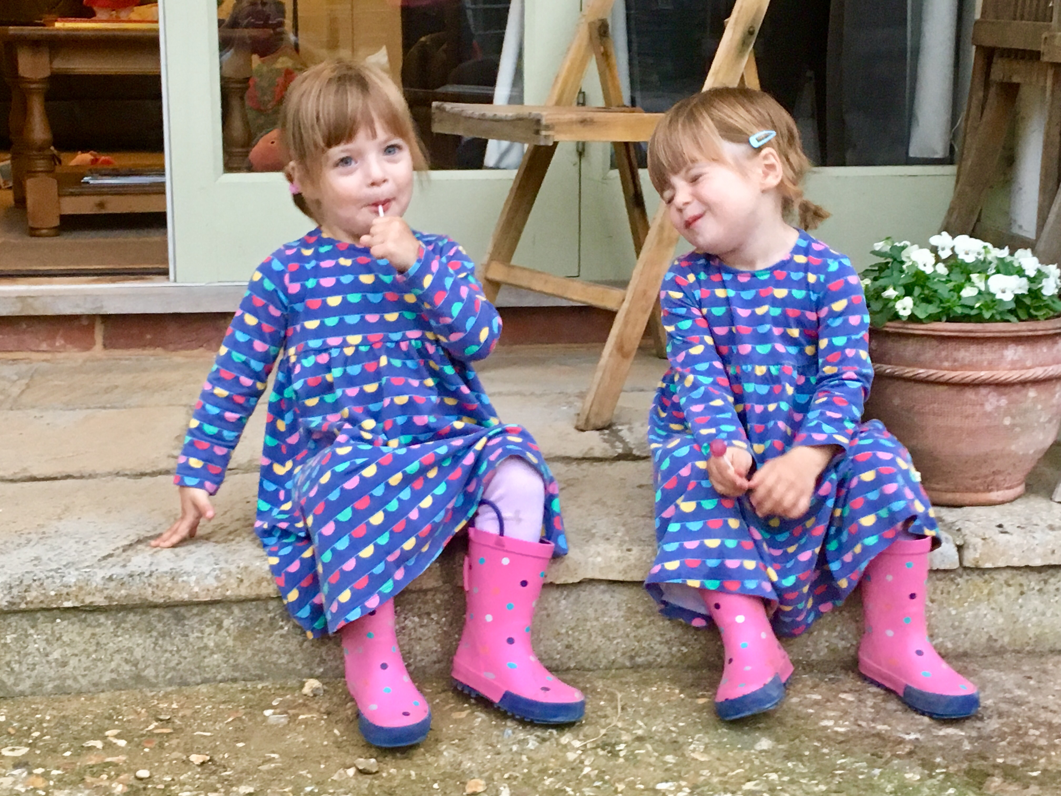 twins sitting on the door step at kennel farm holiday cottages