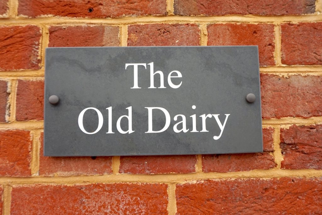 The Old dairy sign at Kennel farm holiday cottages