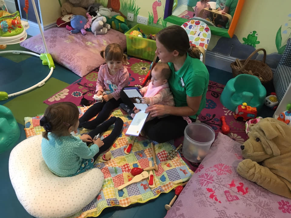 Staff with three Children at the Den in New Park Manor