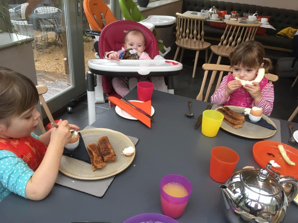 Family sitting down for breakfast in New Park Manor