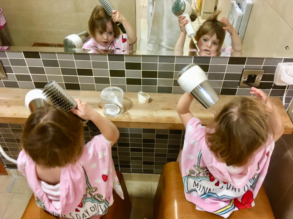 Twins drying their hair in the spa at New Park Manor
