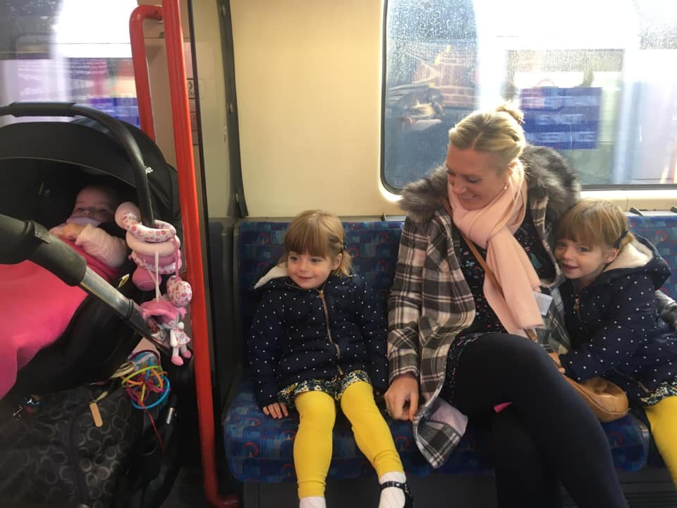 Twins, baby and mum on the trip heading for a day out in London with a toddler