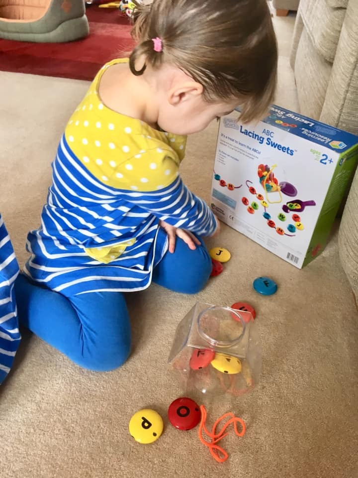 Learning to read through play with abc lacing sweets. Learning Resources toys.