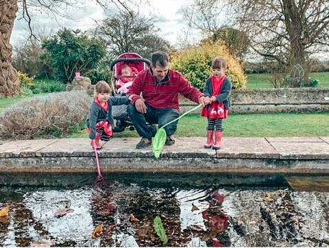 Children pond dipping at The Woolly Grange in Wiltshire. A Luxury Family Hotel.