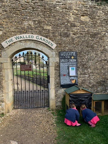Children playing outside in the walled garden at The Woolly Grange in Wiltshire. A Luxury Family Hotel.