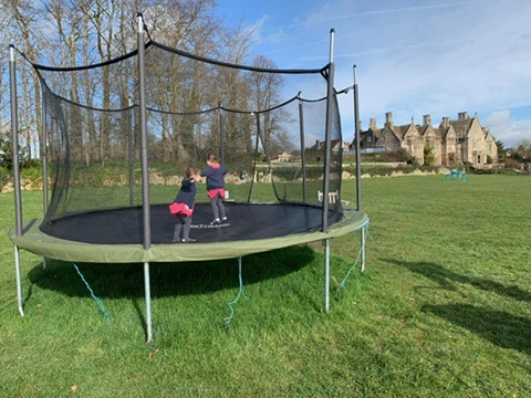 Children playing outside at The Woolly Grange in Wiltshire. A Luxury Family Hotel.