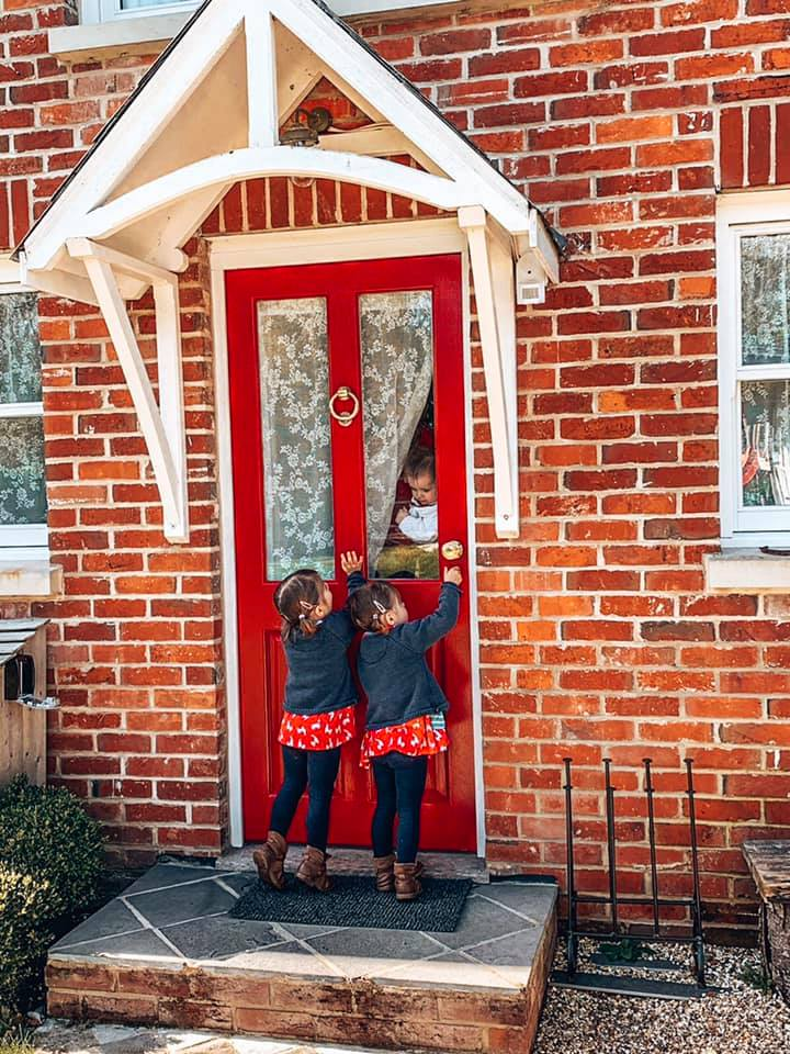 Red front door at Spindle cottage. A family friendly cottage in the New Forest.