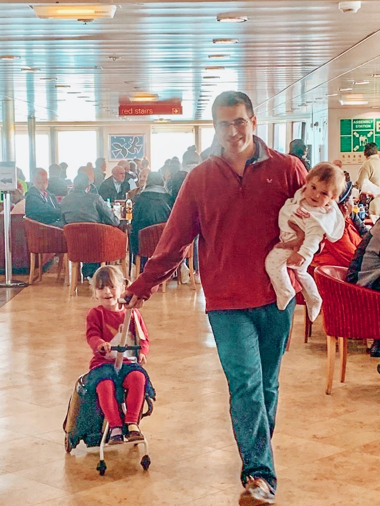 Dad and children on board the ferry.