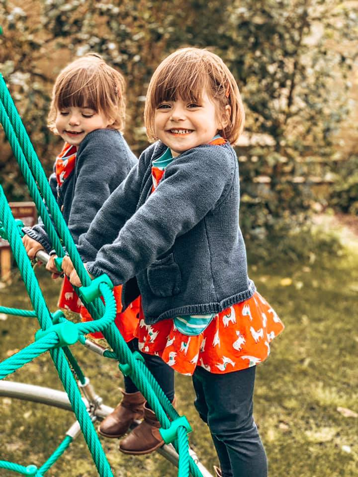 twins playing on the climbing frame at Bruern cottages