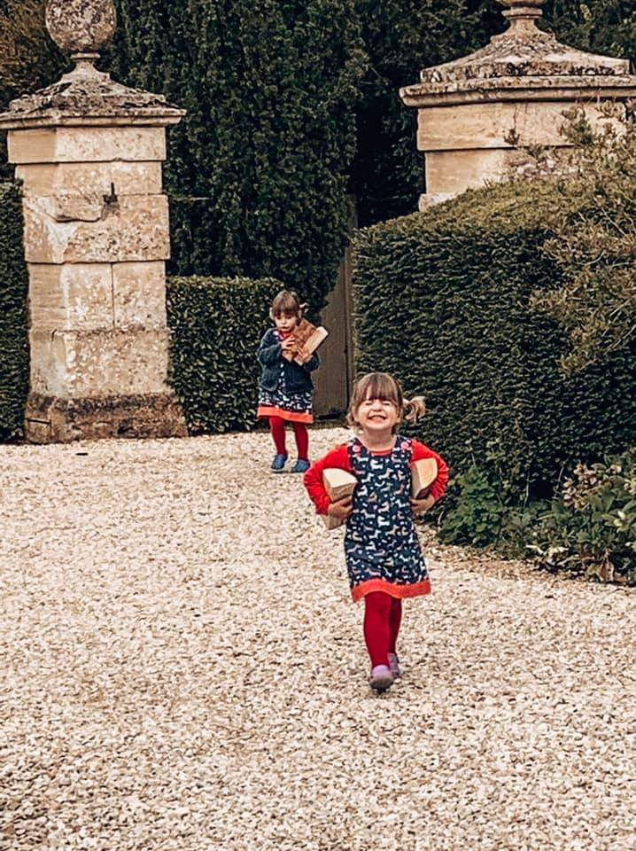 Bruern Cottages in the Cotswolds great for family holidays. Twins collecting wood for the fire in Epsom cottage