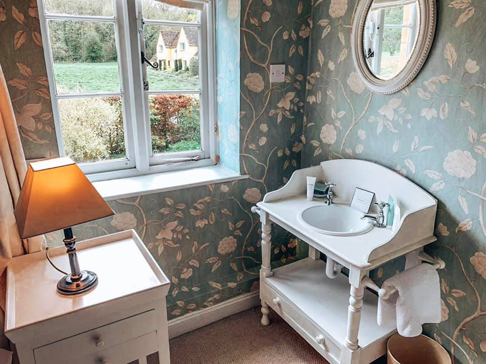 Single bedroom with basin in Epsom holiday cottage at Bruern Cottages in the Cotswolds