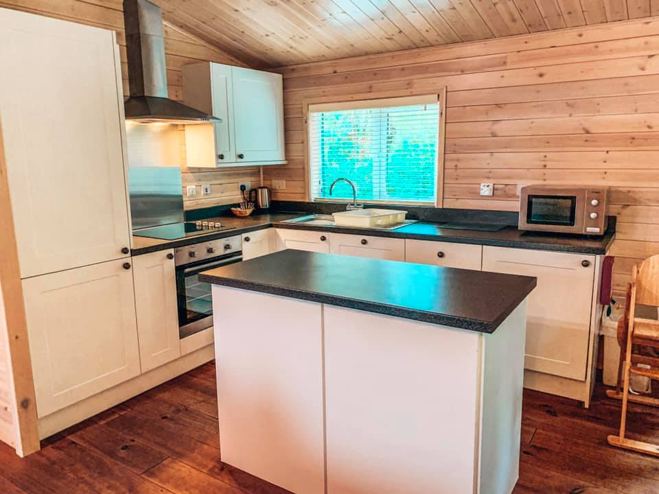 The kitchen area of a luxury lodge at Darwin Forest