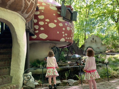 Efteling fairytale theme park. Twins looking at a magical mushroom. Places to visit in Holland.