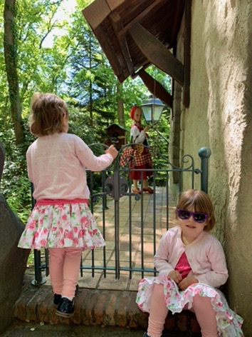 Efteling fairytale theme park. Twins looking at Little Red Riding Hood. Places to visit in Holland.
