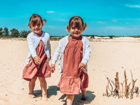 Dunes of Loon and Drunen National Park. Twins playing in the sand. A great place to visit in Holland with kids.