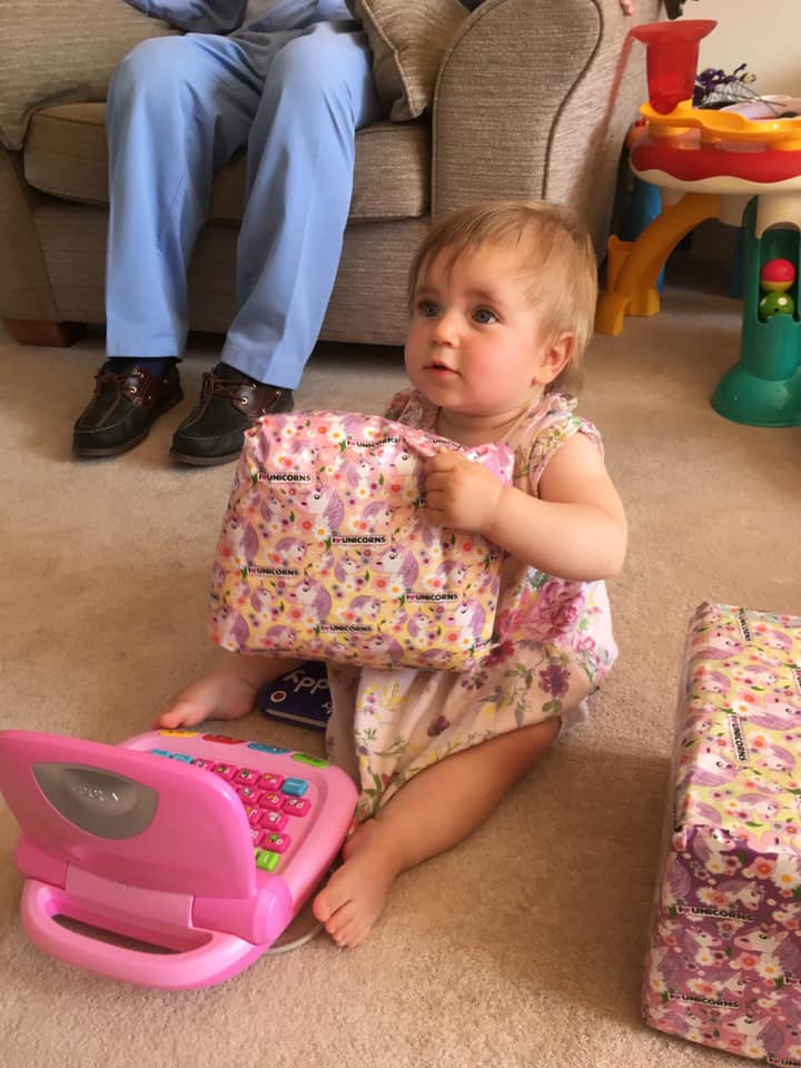 Matilda opening her first birthday presents