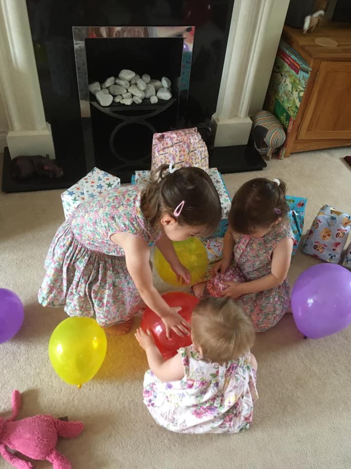 opening 1st birthday presents with twin sisters