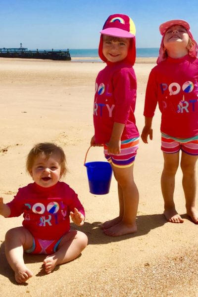 Twins and a baby on Frinton Beach non Essex
