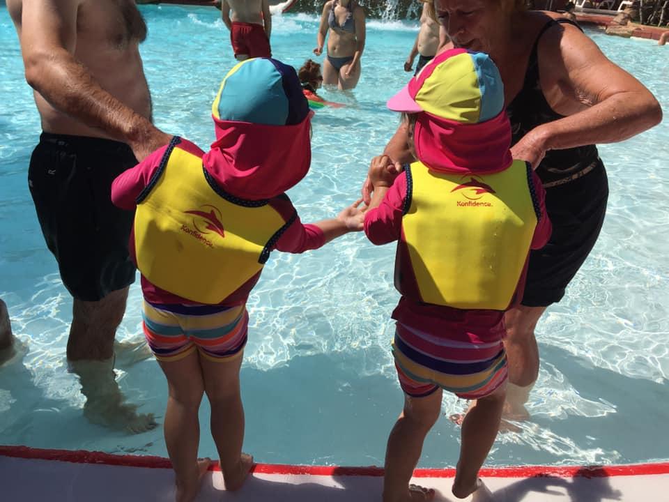 Twins wearing sun hats