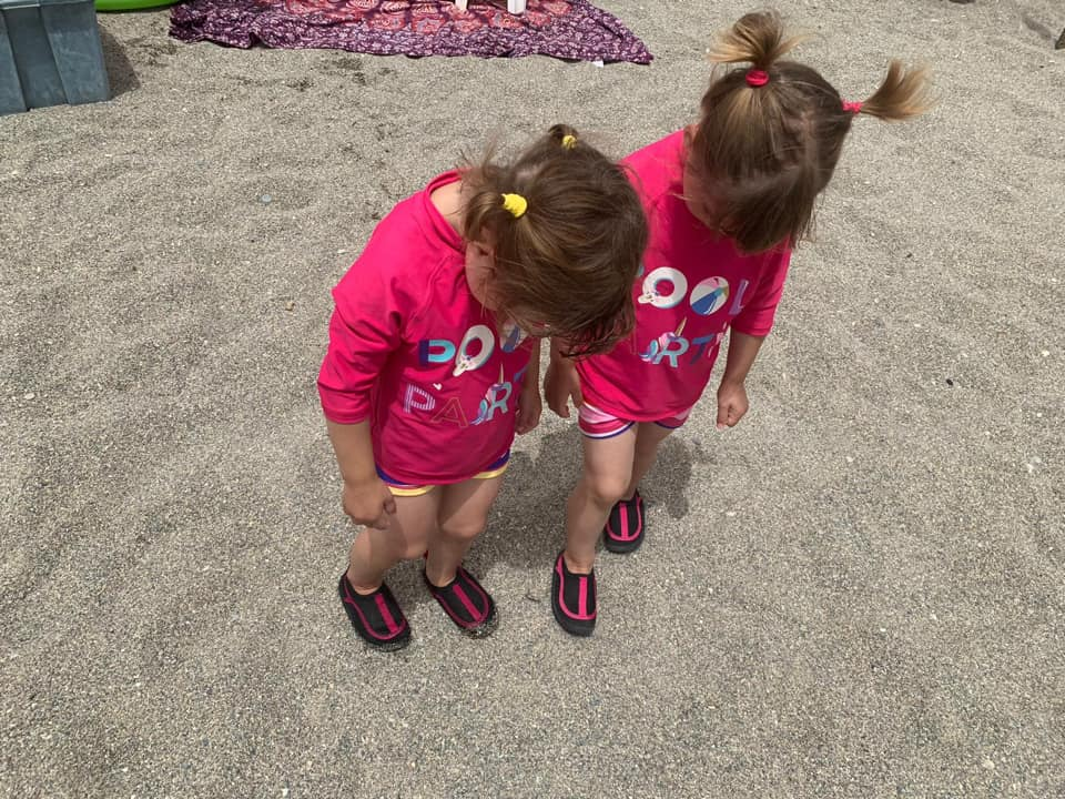 twins wearing their beach shoes