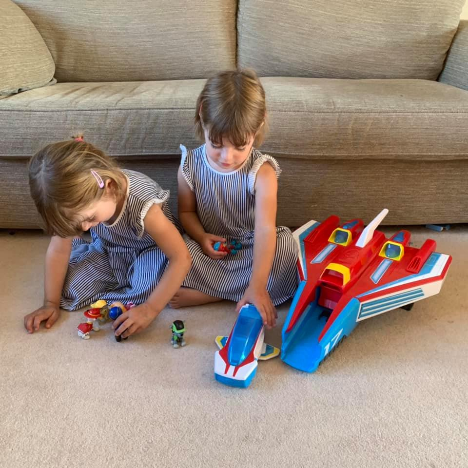 Twins playing with paw patrol pups and ship